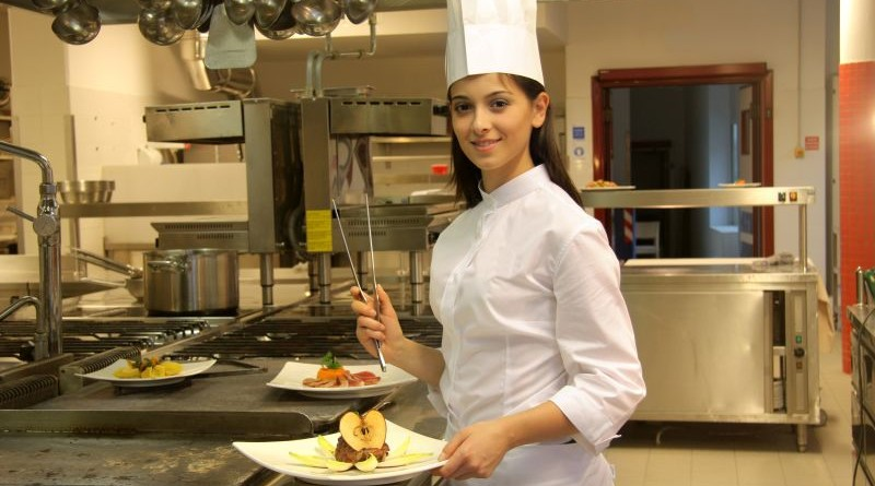 Female cook in the kitchen of a restaurant